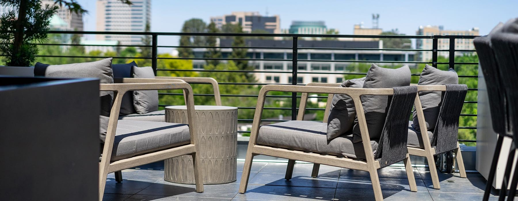 spacious patio with modern seating and views of nearby city skyline