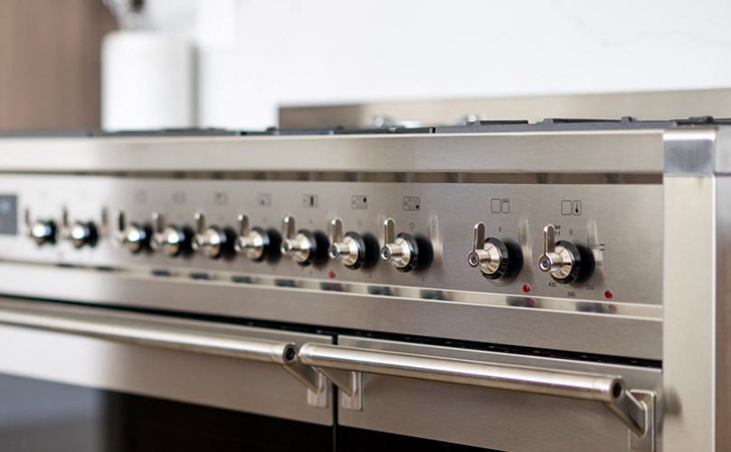 close-up of kitchen appliances and specifically a stainless steel stovetop